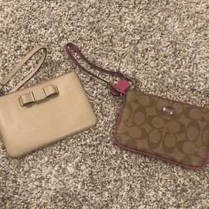 Handbags - Two coach wristlets.